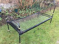 Cast iron single bed frame and sprung base . Good condition but requires mattress.