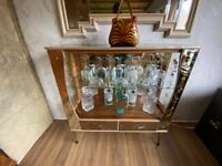 Vintage mid-century glass display unit. Mirror & etched glass. Matching cocktail unit available.