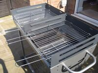 Large charcoal BBQ with cover