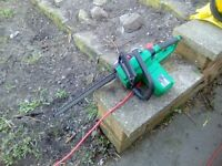 Qualcast 2000W chain saw used once cost £100