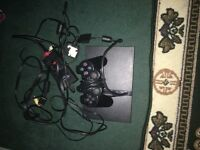 PLAYSTATION 2. WITH 2 CONTOLLERS AND A BUNCH OF GAMES. MINT