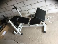 Weight Training Bench with chest, leg and bicep exercise