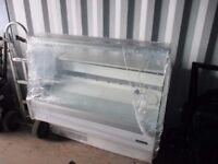Fridge display serve over curved glass fridge