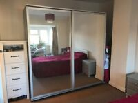 Large double wardrobe with sliding mirror doors