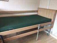 Electric profiling rise and fall nursing single bed.
