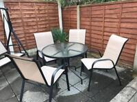 Garden swing, chairs and umbrella