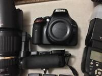 Nikon D5200, 18-70mm lens, battery grip and more..