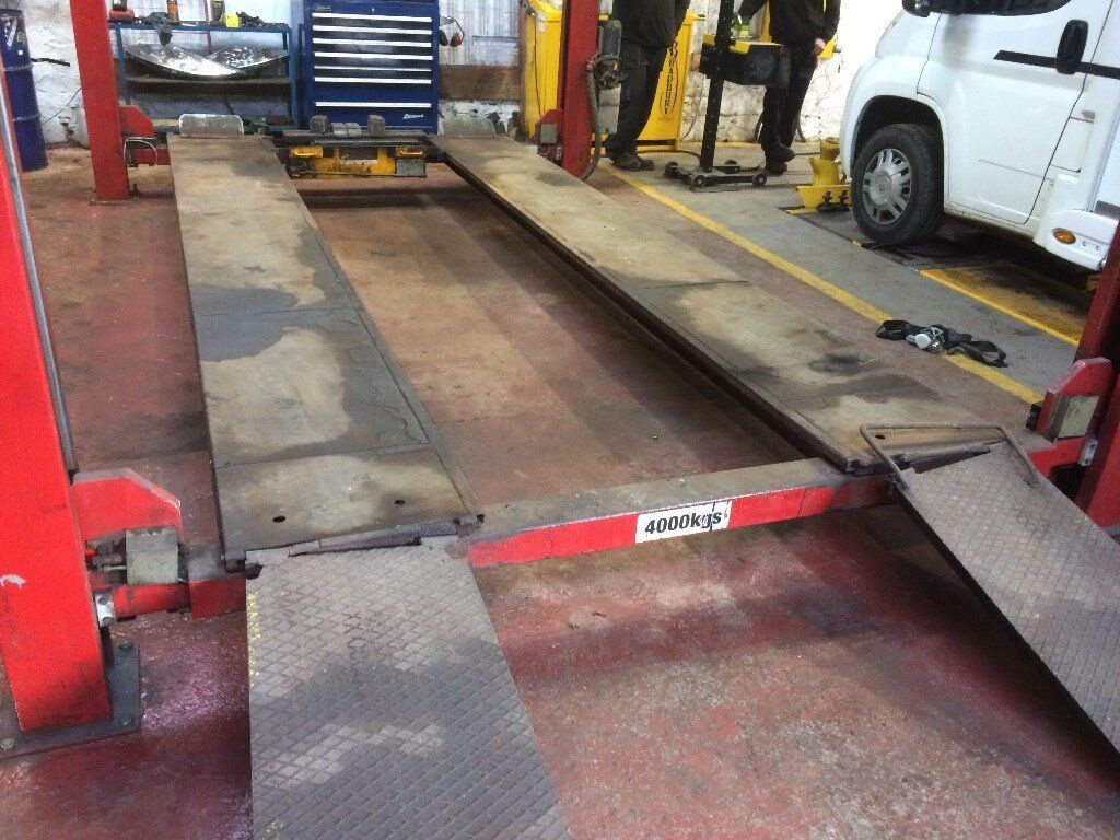 Four post vehicle lift . Car ramp . Three phase . Four ton capacity , Four post ramp . Jacking beam