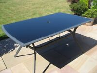 Glass top metal patio table