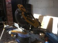 Dewalt mitresaw with leg stand and three blades