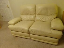 Cream leather 2 seater settee. Both seats have electric recliners and foot rests