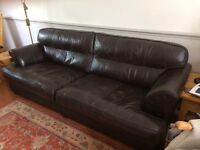 Brown four seater leather sofa