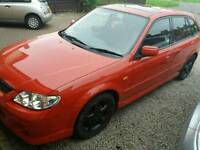 Mazda 323f 2.0 sport 2001 with air con and verry low mileage