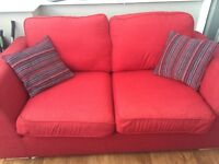 Red sofa/setee with footstool