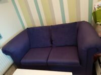 Blue fabric 2 seater sofa and pine coffee table