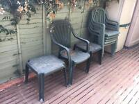 6 plastic garden chairs, two side tables and one arm chair