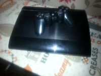 Playstation 3 slim model with 12 games and one controller