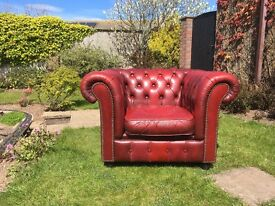 Burgundy Chesterfield chair with matching footstool.