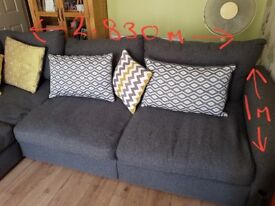 Corner suite grey in colour