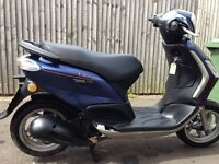 Piaggio fly 125 58 plate 12 months mot