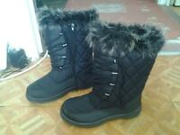 ladies boots, size 5, worn once, perfect for the winter. Black with warm fur inside,. Perfect choice