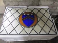 BEAUTIFUL OVER-DOOR STAINED GLASS WINDOW. MEASURES 76CM BY 50CM. ONLY ONE CORNER PANE IS CRACKED.