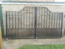 Heavy duty galvanised driveway gates painted black with gold spear tip finials