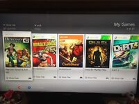 Xbox 360 slim 250GB with 30+ games and two controllers