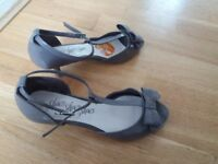 A couple pair of shoes for sale