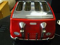Red Deonghi CTO4003R 4 Slice Toaster. Good Working Condition. Clean