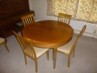 Very attractive extendable dining table & 4 chairs. Circular extending to oblong. Nathan brand