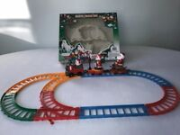 Father Christmas train set....pristine condition...battery included...boxed