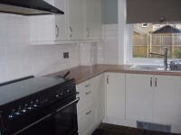 2 bed g/f flat in nice condition with GCH & D/Glazing with front & back garden near town centre