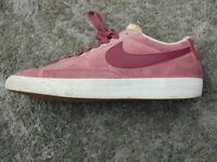 Red Nike shoes, size 8