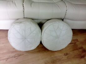 two cream pouffes/footstools