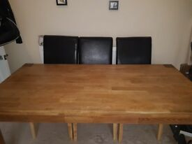 Large solid wood dining table and 5 chairs