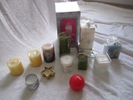 Assortment of one dozen unused candles for sale.
