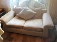 Large two seater sofa with cushions