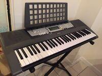 Yamaha ez-200 keyboard and stand