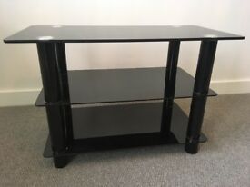 Black tempered glass TV stand - 70cm x 35cm, height 45cm