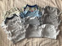 Bundle of baby clothes.