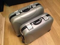 Three combination lock suitcases