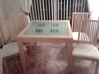 Beautiful Light Oak Extendable Dining Table with 4 Cream Fabric Chairs