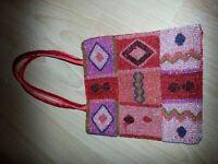 Hand sewn beaded red silk handbag