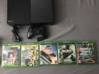 Xbox One 500gb, 5 games and rechargeable pack.