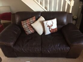 Two Large 2/3 seater DFS dark Brown leather Sofas. in good condition