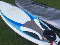 NSP surfboard with leash and fins and storage bag