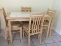 Tiled top kitchen table and 4 chairs . Excellent condition