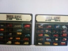 39,Lledo vintage cars&vans,in 2 display cases.OFFERS WELCOME!!!!Excellent condition!