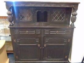 a large onate dark wood side cabinet.